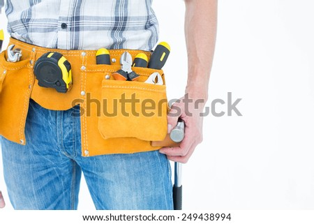 Cropped image of technician with tool belt around waist over white background