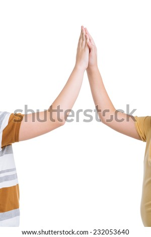 Cropped image of two friends giving each other a high five - stock photo