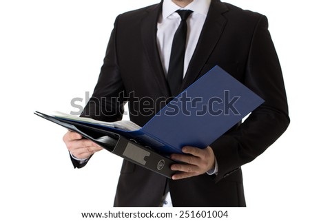Cropped image of well dressed business man with black tie and suite who is holding a folder. Isolated on white background. - stock photo