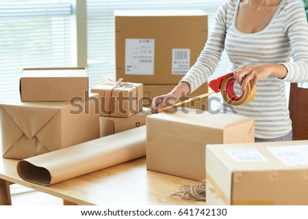 cropped image woman wrapping boxes send stock photo royalty free