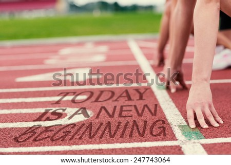 Cropped people ready to race on track field against today is a new beginning - stock photo