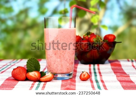 Cropped photo of Several sliced strawberries with leaf and juice isolated on a white backgroun - stock photo