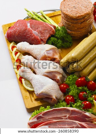 Cropped picture of variety of meats - stock photo