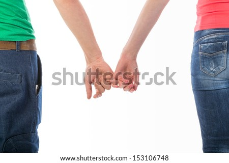 Cropped rear view image of a man and woman in casual clothing holding hands isolated on white