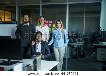 Cropped shot of a businesspeople posing in the office. - stock photo