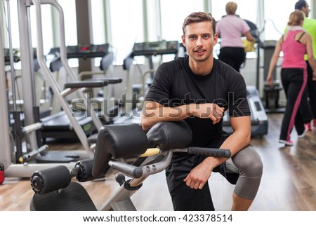 Cropped shot of a happy young man  in gym  - stock photo
