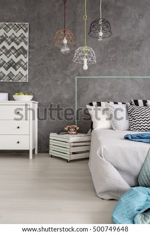 Cropped shot of a minimalist bedroom interior with grey walls and white floor