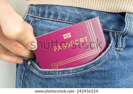 cropped  shot of a woman s pocket with her passport - stock photo