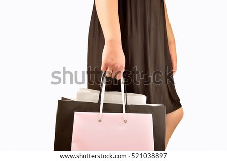 Cropped shot of a young woman shopping and holding bags isolated on white background. Concept of a shopaholic.