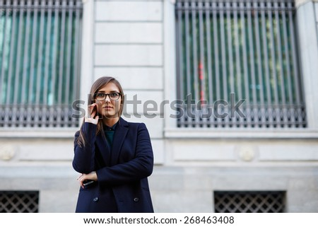 Cropped shot of an attractive smiling woman in an urban setting  - stock photo