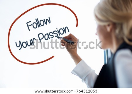 Cropped shot of blonde businesswoman with pen writing business graph on whiteboard