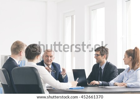 Cropped shot of elegant business associates during an important business meeting - stock photo