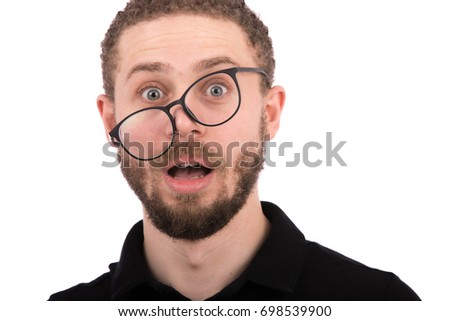 Cropped shot of handsome funny beard young man with a glasses wearing black t-shirt and jeans, isolated on white background