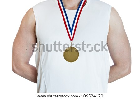 Cropped torso of man standing in attention wearing blank sports gold medal. - stock photo