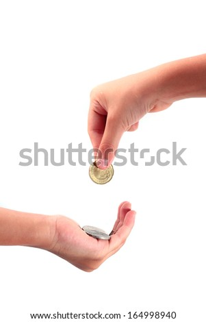 Cropped view of a hand giving a coin to another person
