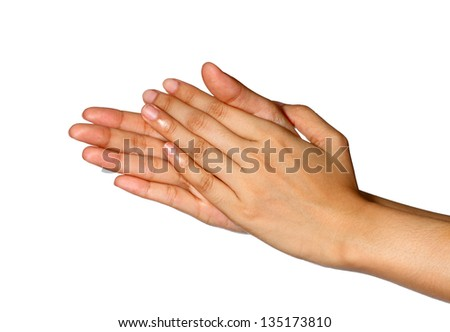Cropped view of a women set of hands with palms rubbing together - stock photo