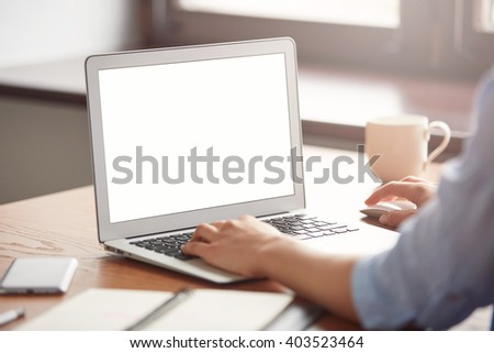 Cropped view of a young office worker sitting at table in cafe enjoying coffee after hard day at work. Female hands keyboarding on laptop with copy space for your text message or promotional content  - stock photo