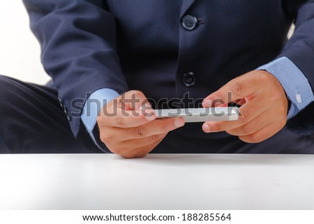 Cropped view of businessman using smartphone