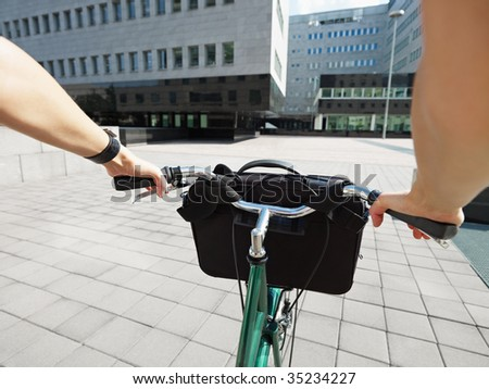 Cropped view of businesswoman going to work by bike - stock photo