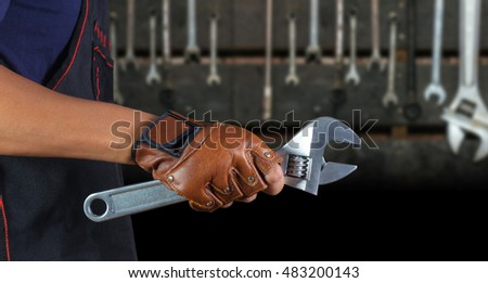Cropped view of Hand with wrench, Motorcycle mechanic