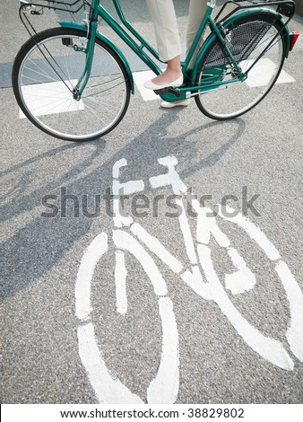 cropped view of woman commuting on bicycle - stock photo