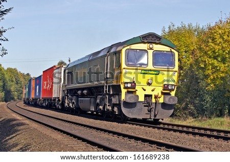 CROPREDY, UK - OCTOBER 24: An intermodal freight train works its way to the south coast from Manchester on October 24, 2013 in Cropredy. In 2011/12 rail transported 101 Mn tons valued at over �£30 Bn - stock photo