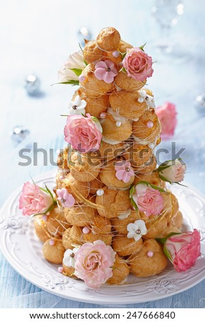Croquembouche with Pink and White Frosting Roses - stock photo