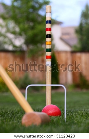 Croquet in the back yard with red ball - stock photo