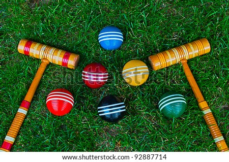 croquet mallet and balls - stock photo