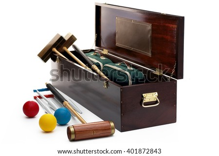 Croquet set with wooden chest on white background