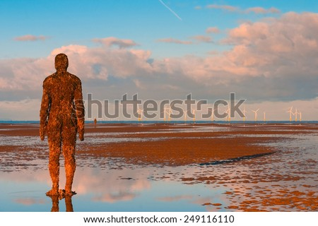 Crosby,Great Britain - September 18,2007: Spectacular sculptures are on Crosby beach.Another Place is a piece of modern sculpture by Antony Gormley. It consists of 100 cast iron sculptures  - stock photo