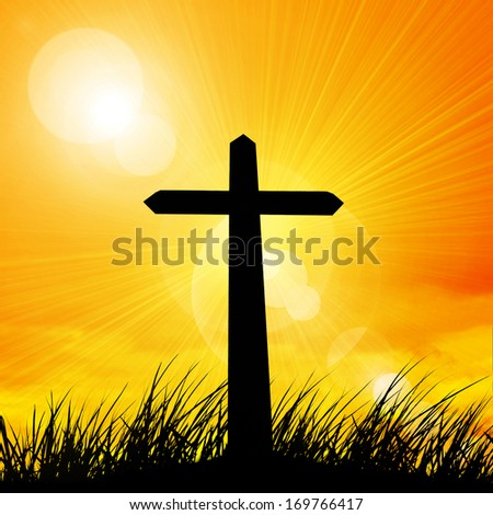 cross a grass and sky at sunset background