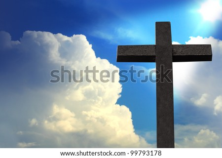 Cross against blue sky - stock photo