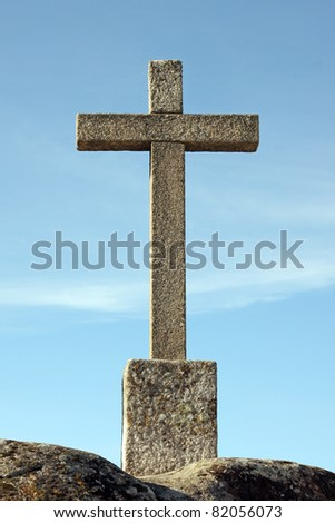 cross against blue sky, Portugal - stock photo