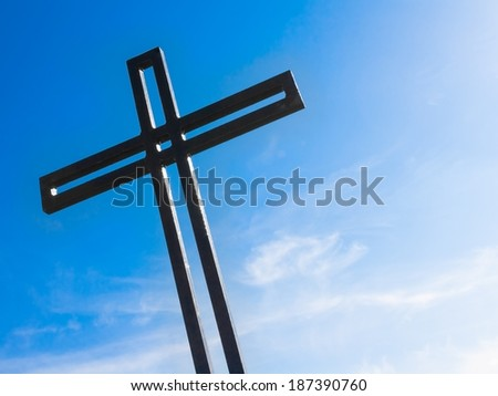 cross against the blue sky, religion and spirituality concept