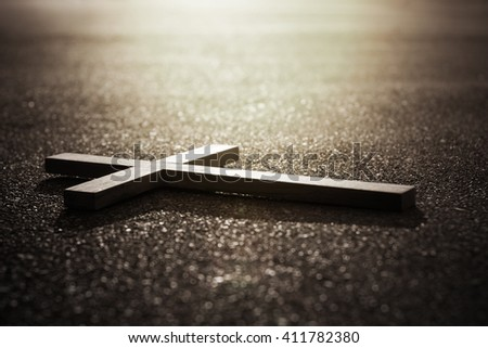 Cross and sunrise on road in dark tone , religion , peace ,freedom concept - stock photo