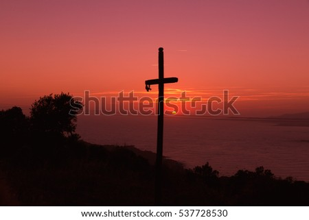 cross and sunset glow