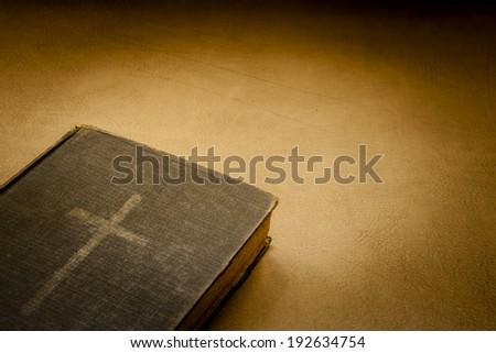 CROSS BOOK, BIBLE  - stock photo