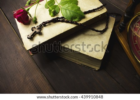 Cross book on roses