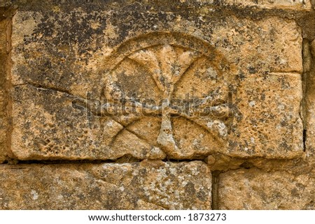 Cross carved in stone. Sarlat cathedral, Dordogne, France