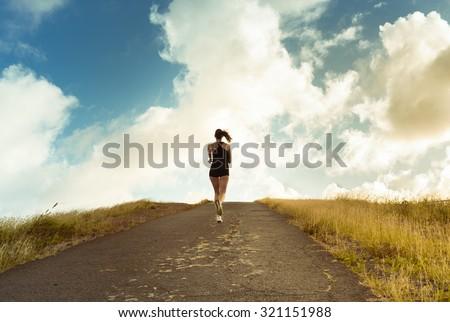 Cross country female runner.  - stock photo