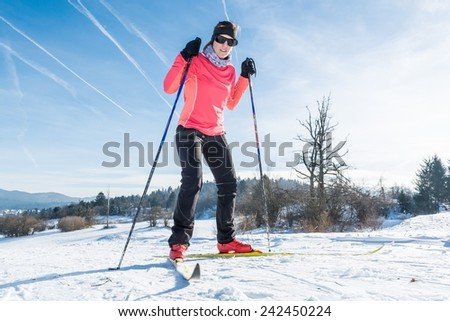 Cross country skiing. Close up of shoes and skis. - stock photo