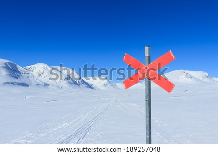 Cross country skiing sign on the famous Kungsleden trail in Sweden. - stock photo