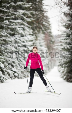 Cross-country skiing: young woman cross-country skiing on a lovely sunny winter day - stock photo