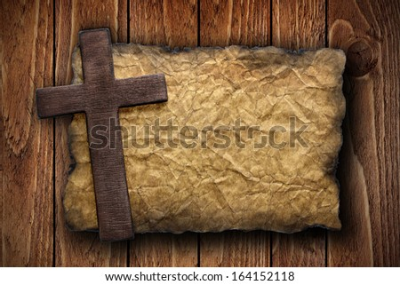 Cross cut out of wood on the old paper, over a wood background, ideal for religion,  or conceptual designs - stock photo