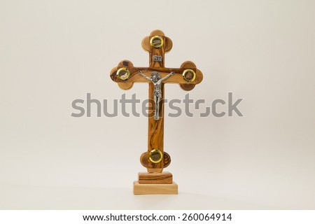 Cross from the Holy Land on a white background. - stock photo