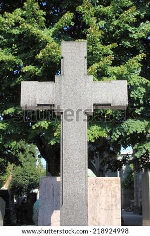 Cross gravestone - stock photo