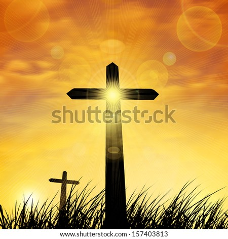 cross in a grass,background sky and clouds
