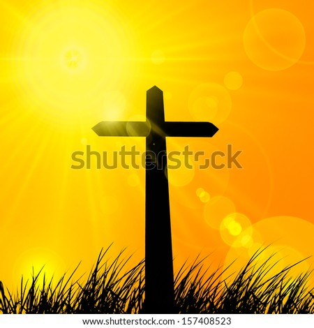 cross in a grass background sky and sun rays