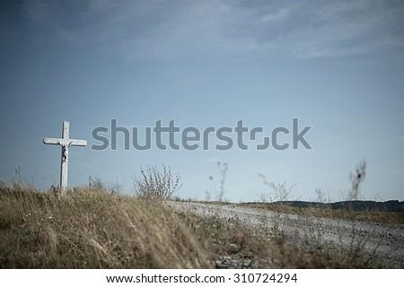 cross in field in Svata Helena in Romania - stock photo